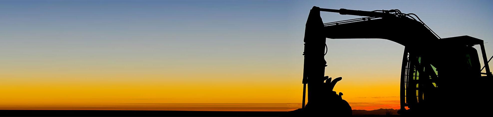backhoe at sunset
